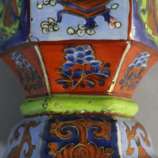 A pair of late 17th century Chinese Kang Hsi clobbered porcelain vases of hexagonal form