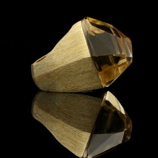 A striking 'Asymmetric' dress ring set with a large pale yellow irregular cut citrine in 18ct gold.
