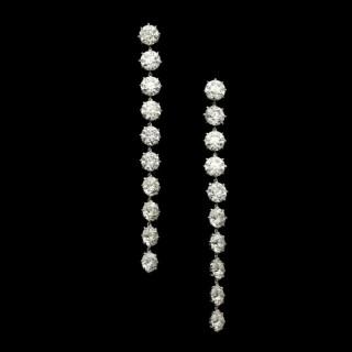 A stunning pair of old European brilliant cut diamond long drop earrings in platinum.