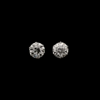 A classic pair of platinum and old European brilliant-cut diamond ear studs, weighing 2.38cts total.