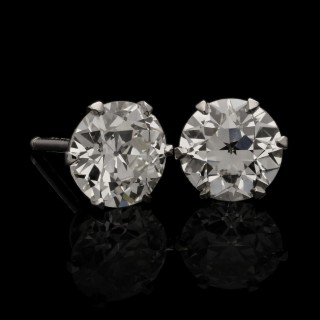 A classic pair of platinum and old European brilliant-cut diamond ear studs, weighing 1.84cts total.
