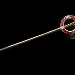Cartier ruby and diamond winning post pin, French, circa 1910.