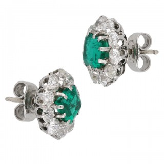 Edwardian Colombian emerald and diamond cluster earrings, circa 1910.