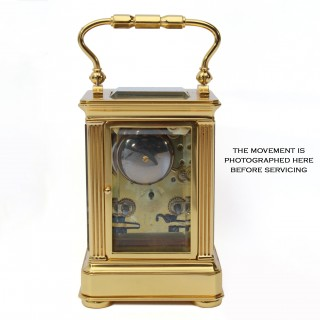 Bell-striking carriage clock with engraved dial