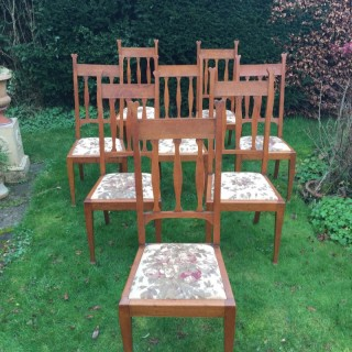 Set of Eight Golden Oak Arts & Crafts Dining Chairs Retaining the Original Label
