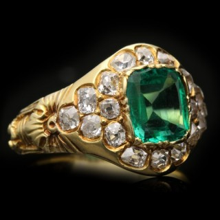 Victorian colombian emerald and diamond cluster ring, circa 1900.