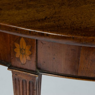 An 18th century mahogany demi-lune side, console or serving table.