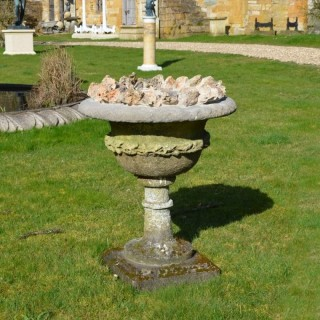 A late 19th century carved stone urn of campana form