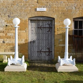 A large pair of 19th century cast iron lamp stands