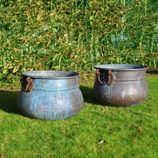 A pair of vintage copper cauldron garden planters