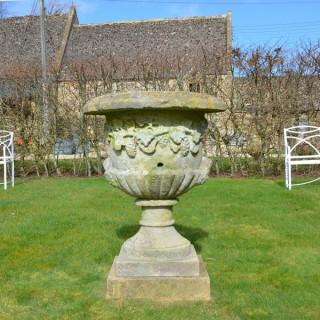 A large mid 19th century carved stone urn