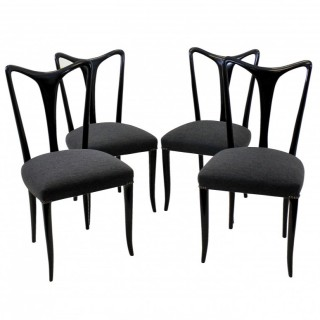 A SET OF FOUR EBONISED ULRICH DINING CHAIRS