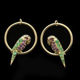 A charming pair of gold and multi gem-set parrots suspended from classic diamond hoop earrings.