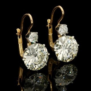 A stunning pair of old European brilliant cut diamond earrings weighing 7.45cts in total.