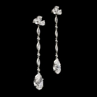 A beautifully elegant pair of diamond drop earrings with D colour vintage-cut pear shape diamonds.