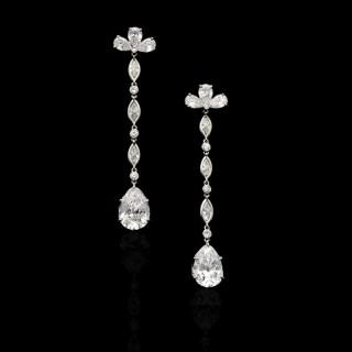 A beautifully elegant pair of diamond drop earrings with D colour vintage-cut pear shape diamonds.