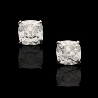 A beautiful pair of cushion shape old mine cut diamond ear studs weighing 1.42cts in total.