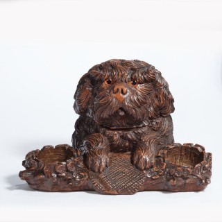 A 'Black Forest' walnut tobacco box in the form of a long-haired dog