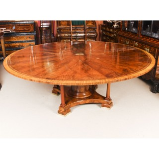 7ft diam Flame Mahogany Jupe Dining Table Early 20th Century & 10 antique chairs