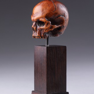 A German Carved Boxwood 'Memento Mori' Skull Probably from a Devotional Crucifix