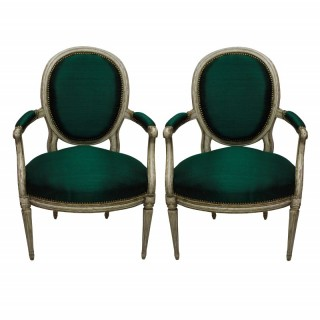A PAIR OF FRENCH XVIII CENTURY ARMCHAIRS