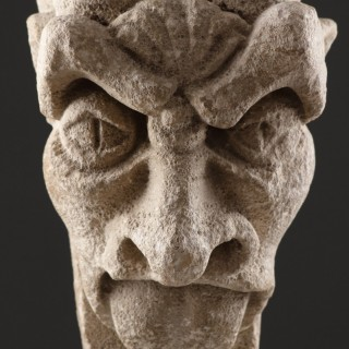 English Medieval Carved Limestone Grotesque of a Long Tongue Poking Demon