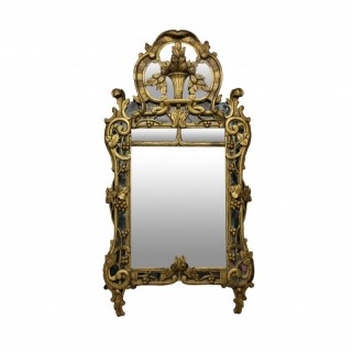 A FRENCH PROVINCIAL MIRROR WITH THE ORIGINAL LOOKING GLASS