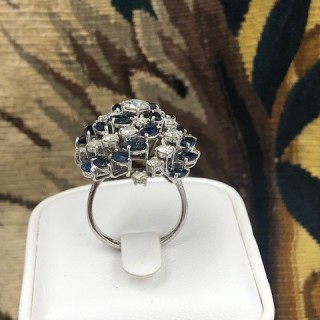 A very stylish 18 Carat White Gold, Sapphire and Diamond Cocktail Ring, English, Circa 2000.