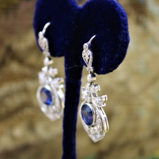 An exceptionally fine pair of Natural Sapphire and Diamond Drop Platinum Earrings, English, Circa 1910.
