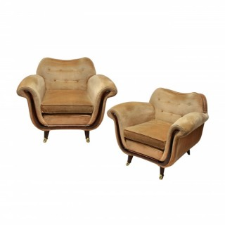 A PAIR OF LARGE LOUNGE CHAIRS BY GUGLIELMO ULRICH