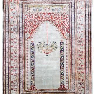 Antique Silk Ghiordes rug