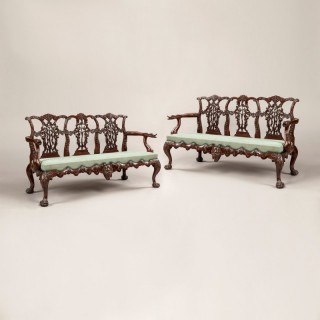 A Pair of Carved Mahogany Settees