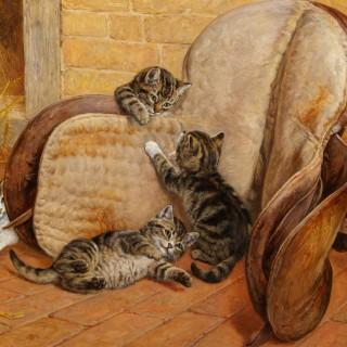 Kittens playing around a Saddle