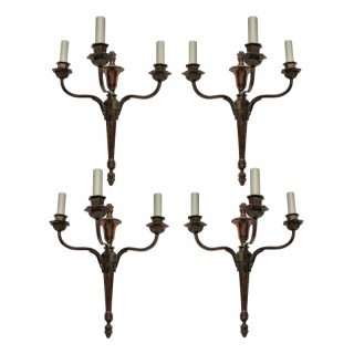 FOUR BRONZED NEO-CLASSICAL THREE BRANCH SCONCES