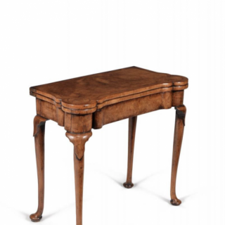 A fine and rare Queen Anne burr and highly figured walnut card table, circa 1710