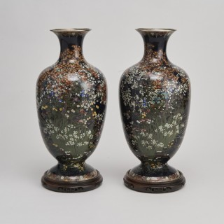 A stunning pair of Japanese Meiji period silver wire cloisonne vases
