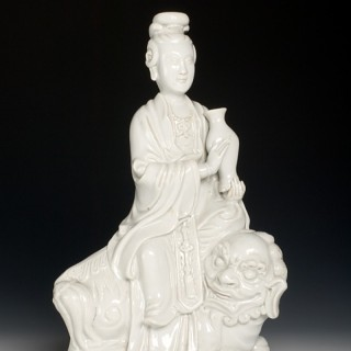 Chinese export Dehua porcelain (blanc-de-Chine) figure of a maiden seated on a Buddhist lion, 19th century, Qing dynasty.