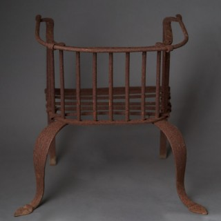 An unusual late 19th century English wrought iron firegrate