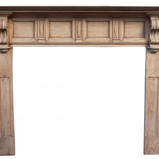 An Antique Victorian Style Carved Pine Fire Surround