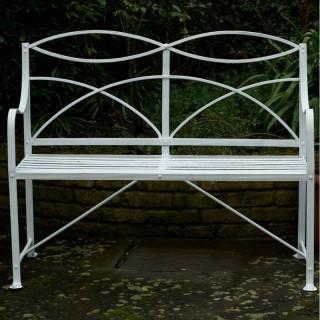 An early 19th century Regency wrought iron garden seat