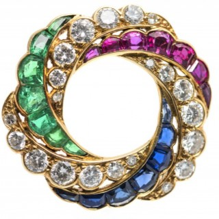 19th Century Catherine Wheel Brooch, Emerald, Diamonds and Sapphires in 18 Carat Gold, English circa 1890