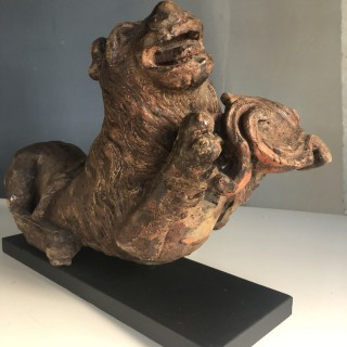 Carving of a lion with a shield late 16th Century