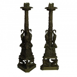 A PAIR OF PIRANESI BRONZE CANDLESTICKS