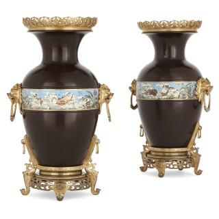 Two Chinese style enamelled gilt and patinated bronze urns