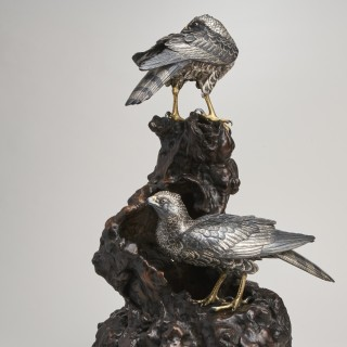 A pair of Japanese Meiji Period multimetal hawks on a root wood base