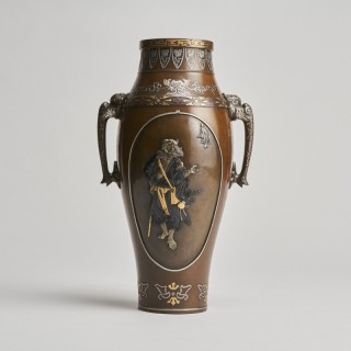 A Japanese Meiji Period bronze vase with multimetal decoration