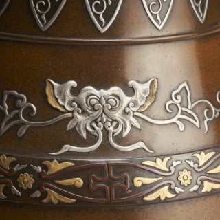 A Japanese Meiji Period bronze vase with multimetal decoration