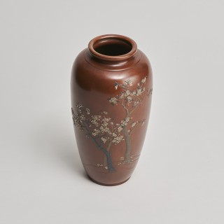 A Japanese Meiji Period bronze vase with multimetal cherry blossom decoration
