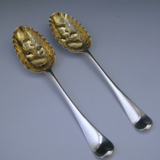 A pair of George II Antique Sterling Silver Berry Spoons, by James Tookey in 1757.
