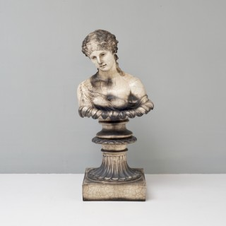 Female bust on stand
